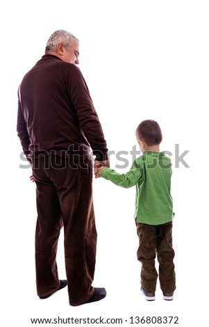 Senior man holding his grandson's hand, back view, isolated on white background