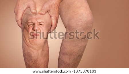 Senior man holding the knee with pain. Collage. Concept of abstract pain and despair. The elderly pensioner and problems. Old age and illnesses. 86-year-old Caucasian model. healthcare concepts