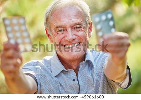 Senior man holds medicament with joy in the nature #459061600