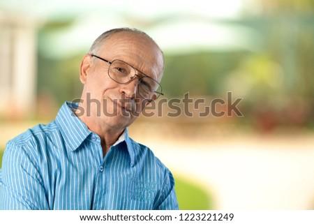 Senior man in blue shirt and glasses #1223221249