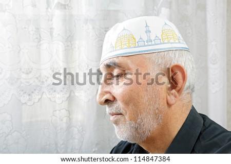 Senior man in religious hat profile view portrait