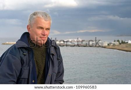 Senior man looking away against the sea