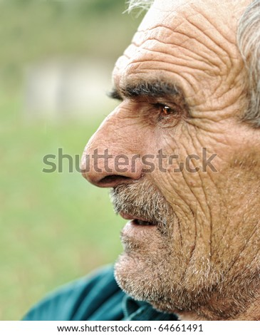 Senior man looking off into distance - profile