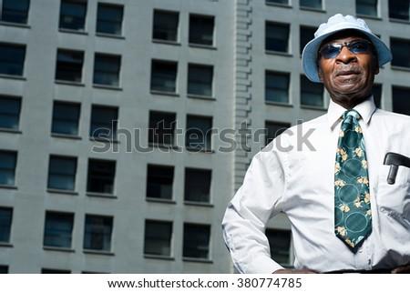 Senior man outside a building