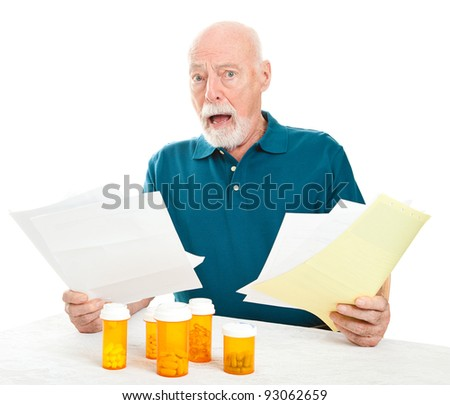 Senior man overwhelmed by the cost of his medical care and prescription drugs.  White background.