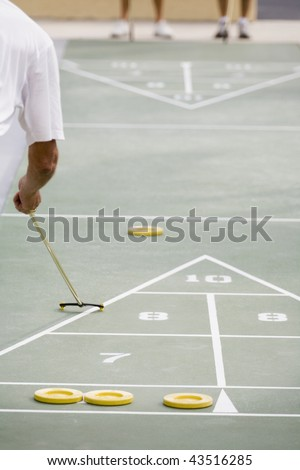 Senior man playing shuffleboard