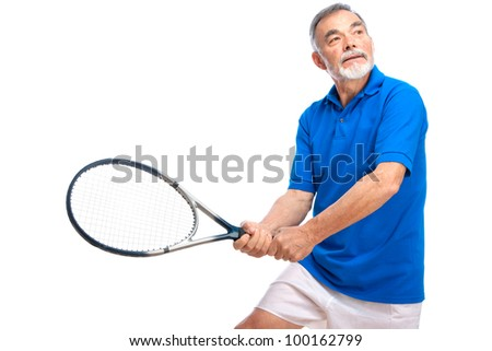 senior man playing tennis. Isolated on white