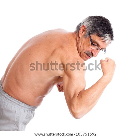 Senior man posing and showing his biceps, isolated on white background.