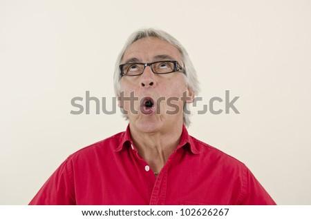 Senior man rolling eyes in disbelief