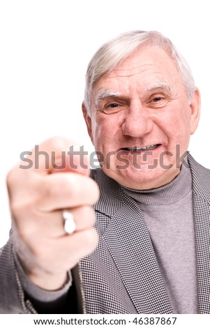 senior man showing fig on a isolated white background