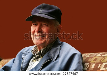 Senior man sitting in waiting room of hospital