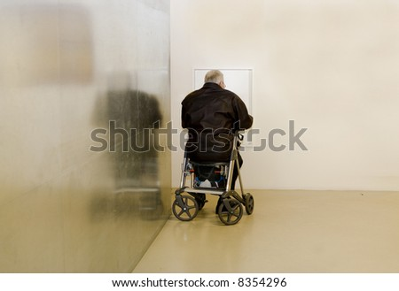 senior man sitting on his walker waiting