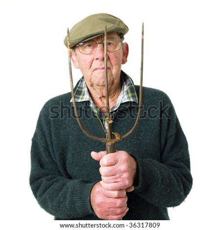 Senior man standing with pitch fork