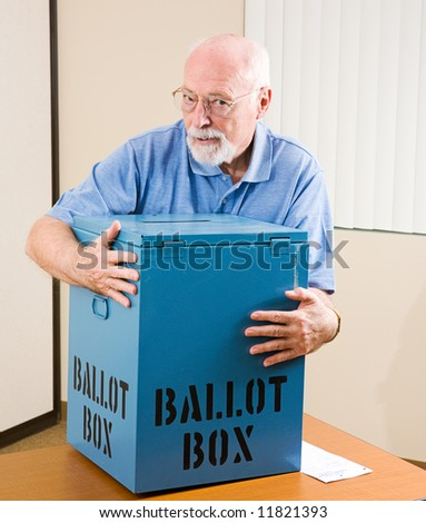 Senior man stealing a ballot box from an election polling place.