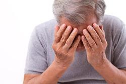 senior man suffering from headache, stress, migraine