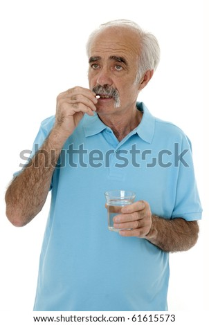 Senior man taking tablet isolated on white