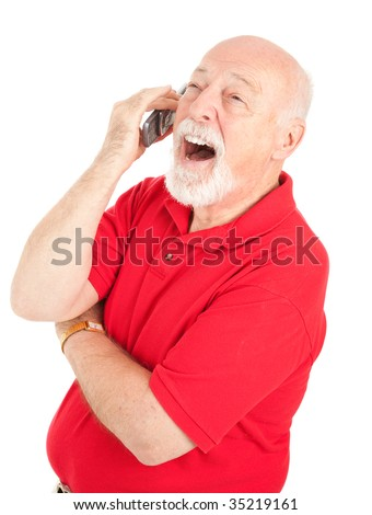 Senior man talking on his cellphone laughs out loud.  Isolated on white.