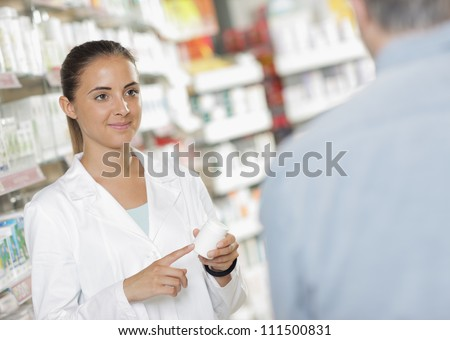 Senior man talking with woman pharmacist