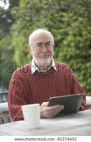 Senior man using a Tablet PC