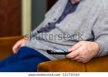 Senior man using remote control