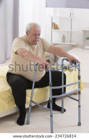Free photos Old man is using zimmer frame for walking | Avopix.com