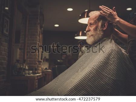 senior man visiting hairstylist ...