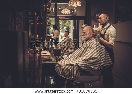 senior man visiting hairstylist ...