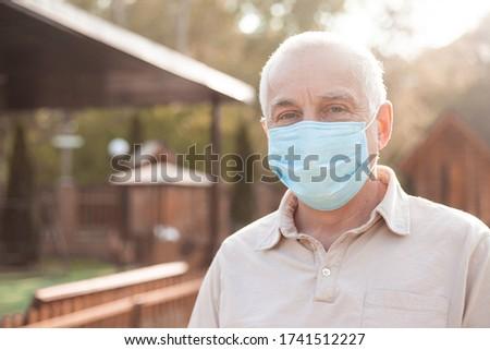 Senior man wears protective mask against infectious diseases and flu, health care concept. coronavirus quarantine.