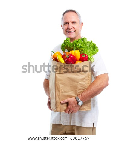 Senior man with a grocery shopping bag. Isolated on white background. - stock photo