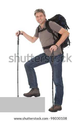 Senior man with backpack and hiking poles. Isolated on white