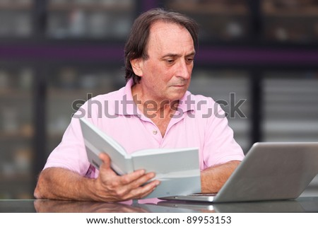 Senior Man with Computer at Office