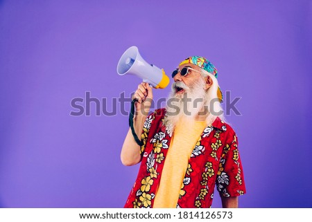 Senior man with eccentric look  - 60 years old man having fun, portrait on colored background, concepts about youthful senior people and lifestyle Foto stock ©