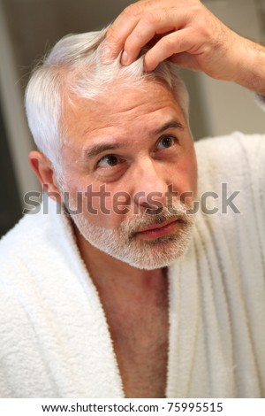 Senior man with hair loss problems