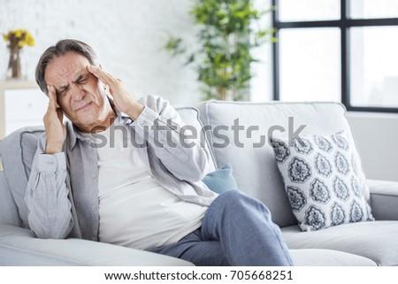 Senior man with headache Foto stock ©
