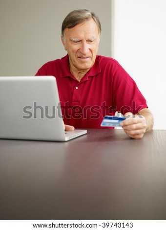 senior man with laptop computer and credit card. Copy space