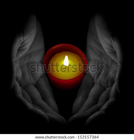 Senior man with remembrance, votive candle - ideal All Saints Day etc. Note: selective colour.