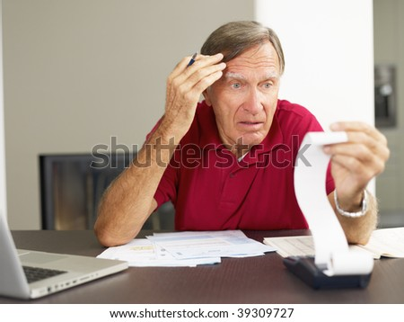 Senior man worried about his home finances. Copy space