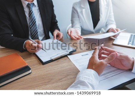 Senior manager HR reading a resume during a job interview employee young man meeting Applicant and recruitment