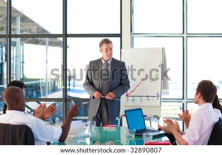 Senior manager in a presentation with his colleagues