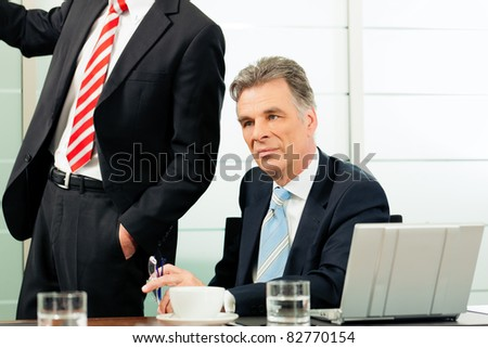 Senior Manager or boss in meeting contemplating new strategy