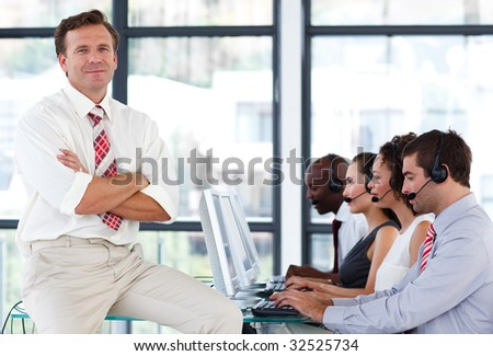 Senior manager with crossed arms working in a call center