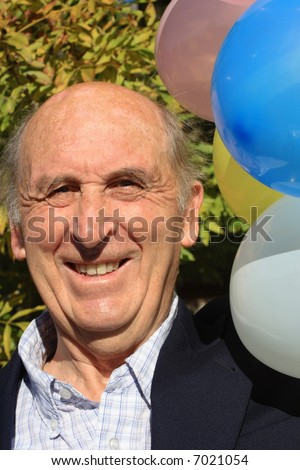 stock photo : Senior mature man enjoying a retirement or birthday party with ...