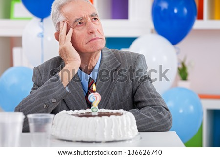 Senior men sitting front of cake birthday ask yourself how old am I