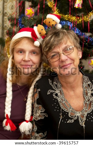 Senior mother and her adult daughter. Happy New Year party.