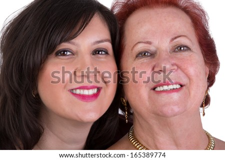 Senior mother and her middle age daughter cheek to cheek portrait