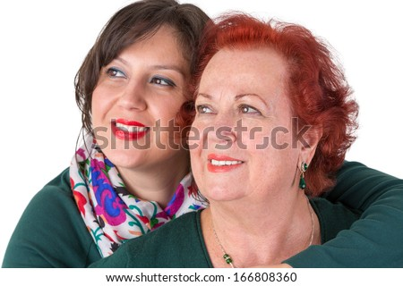 Senior mother and her middle age daughter close to each other portrait, perhaps its mother's day