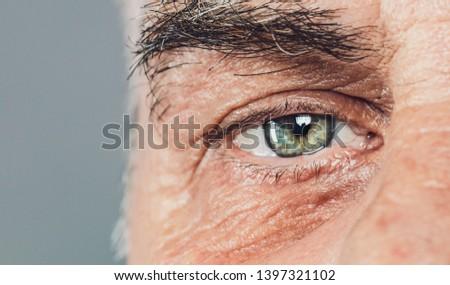 senior old man eyes close-up macro shot