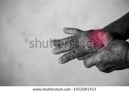 Senior old man having problem trigger finger. Hand trigger finger lock, concept healthy.
