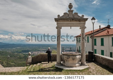 Senior old Man looking panorama from the top of Sacred Mount or Sacro Monte of Varese, Italy