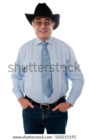 Senior old man wearing a cowboy hat isolated on white